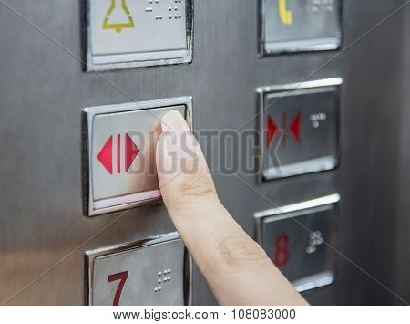 Hand Press Open Door Button In Elevator