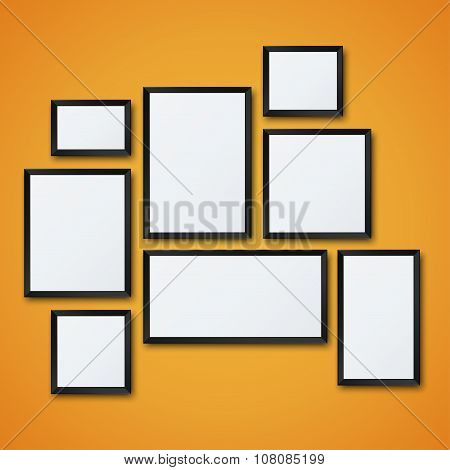 Vector blank picture frame set on orange wall