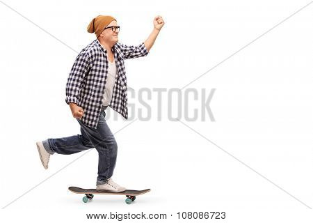 Profile shot of a joyful senior skater riding a skateboard isolated on white background