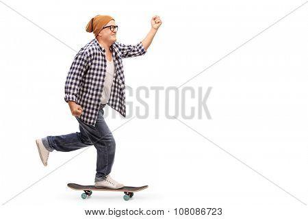 Profile shot of a joyful senior skater riding a skateboard isolated on white background