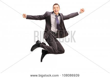 Full length portrait of an overjoyed businessman jumping and gesturing happiness shot in mid-air isolated on white background