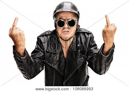 Studio shot of an angry senior biker showing middle finger with both hands and looking at the camera isolated on white background