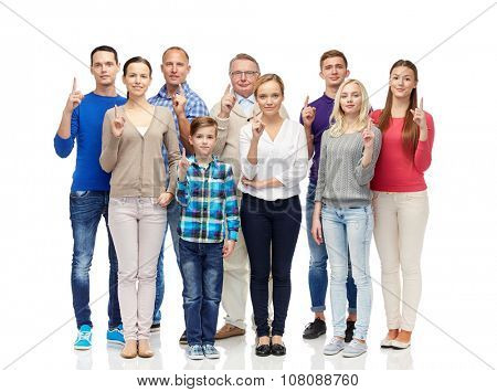 family, gender, generation and people concept - group of smiling men, women and boy pointing finger up