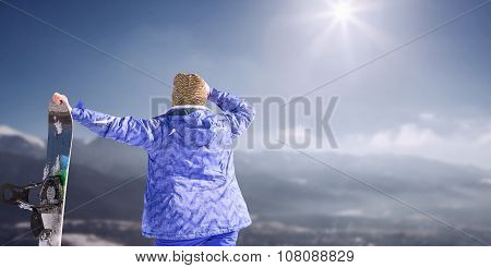 Woman With Snowboard On The Snow Mountain Panorame
