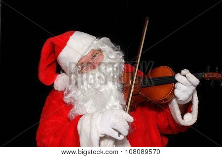 Santa Claus plays the Violin