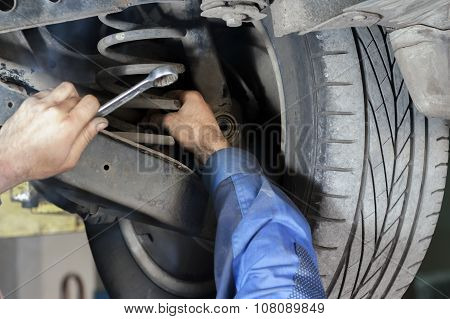 Mechanic Fixes Suspension