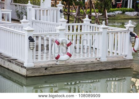 Lifebuoys On Wooden Fence