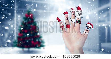 Christmas caroler fingers against home with christmas tree