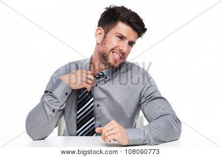 Businessman loosening his tie