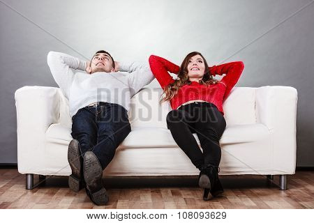 Happy Couple Relaxing Resting On Couch At Home.