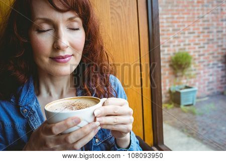 Mature student having coffee in cafe at the university