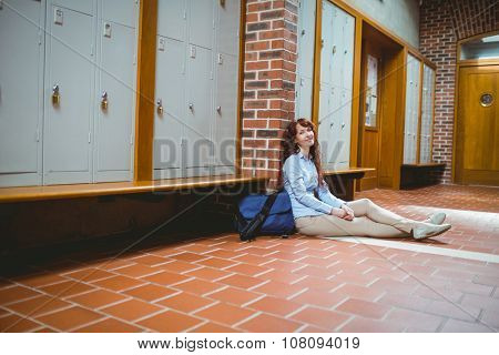 Mature student smiling at camera in hallway at the university