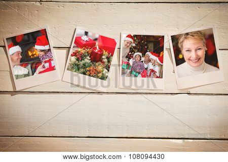 Instant photos on wooden floor against portrait of a smiling active seniors at christmas