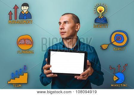 Male from businessman holding a tablet and is looking towards th