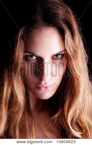 Beautiful Blonde Woman, Isolated On Black Background. Studio Shot.