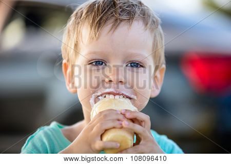 Cute little boy eating ice-cream