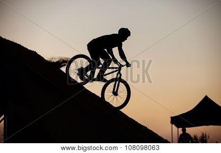 Extreme rider before making a bike jump