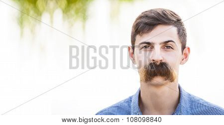 Young man with fake mustaches.