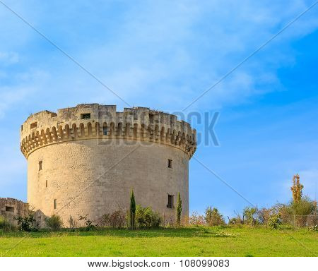 Ruins Of Medieval Old Tower Of Castle Under Blue Sky With Cloud