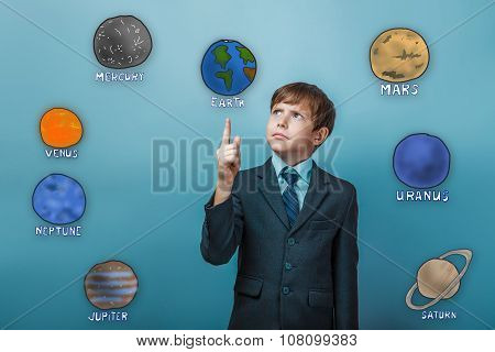 Teenage boy in a serious suit points a finger of the planet of t