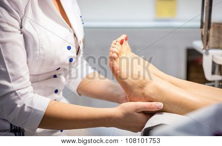 Cropped view of woman getting foot massage