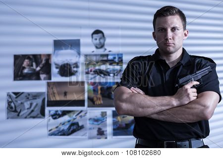 Muscular Man With Gun