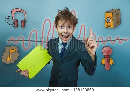 Teenage boy holding a tablet businessman raised his finger up an