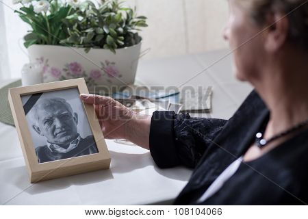 Widow Looking At The Photo