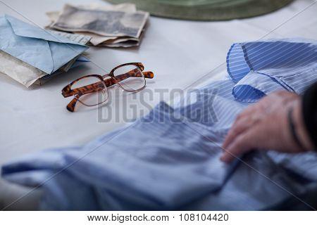 Woman Touching An Old Shirt