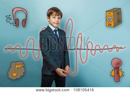 Teenage boy in suit business style folded his hands and is looki