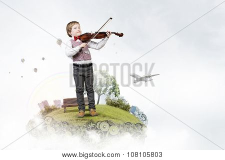 Adorable boy wearing red bowtie and playing violin