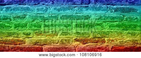 Concept or conceptual colorful painted or old vintage grungy brick wall texture or urban background banner