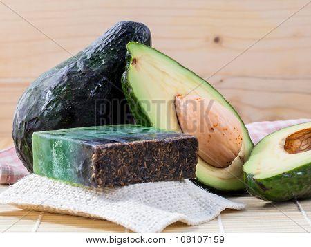 Alternative Skin Care  And Scrub Fresh  Avocado  And  Avocado Soap On Wooden Background.