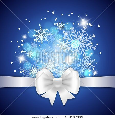 White Ribbon And Bow On Blue Background.