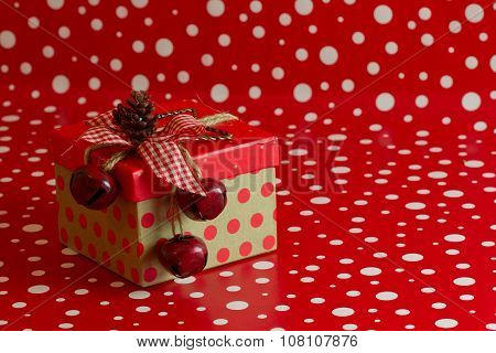 A Country Christmas Present On A Red And White Polka Dot Background