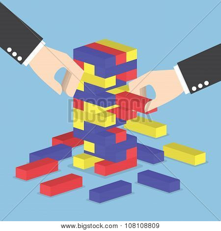 Businessman Hands Play Wood Block Tower Game