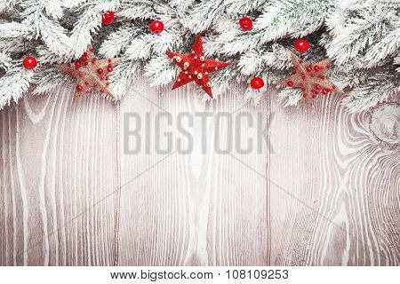 Christmas decorations with stars and snow on wood background