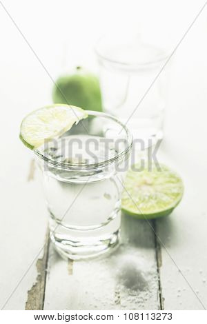 Vodka Shot With Lime And Salt On Wooden Table Background