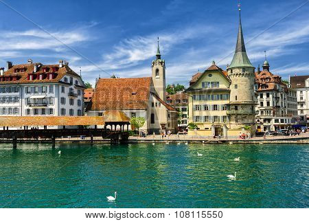 Lucerne, Switzerland, View Over Reuss River To The Old Town, The Chapel And Wooden Chapel Bridge