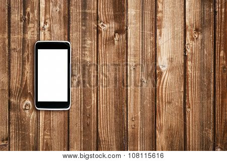 Cell Phone On Wooden Table Top View