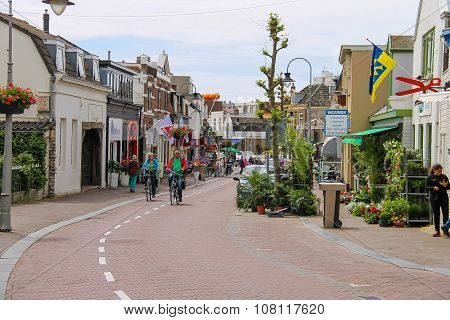 People Riding Bicycles On Haltestraat Street In Zandvoort, The Netherlands
