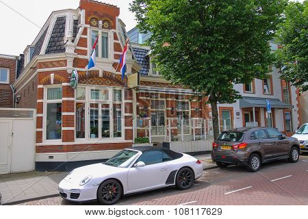 Parked Autos In Front Of The Picturesque Vintage Building In Zandvoort, The Netherlands