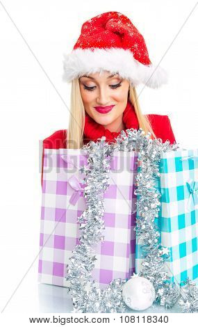 Happy Christmas Woman Looking In To Shopping Bags - Gift. Isolated On White, Close Up