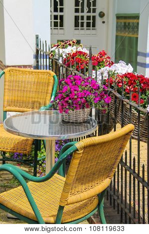 Small Table And Two Chairs On A  Fenced Terrace Near The Building. Zandvoort, The Netherlands