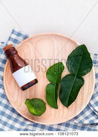 Alternative Health Care Fresh  Kaffir Llime Leaves And Oils On Marble Background.