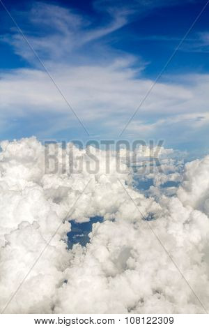 Aerial view over the clouds on blue sky,Top view.