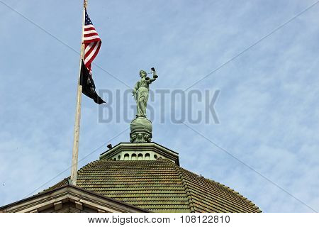 Justice statue and flags