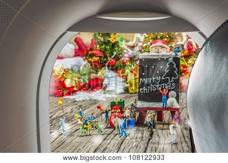 Image Of Plane Window And Christmas Ornaments On Wood Background