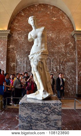 Paris, France - May 13, 2015: Tourists Visit The Venus De Milo Statue At The Louvre Museum In Paris.