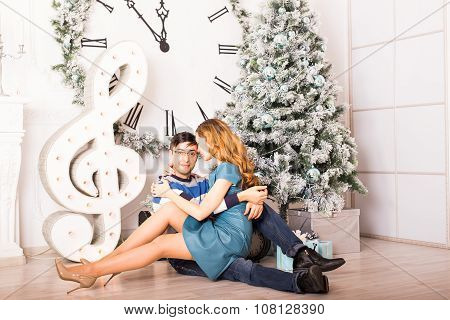 Christmas Couple.Happy Smiling Family at home celebrating.New Year People